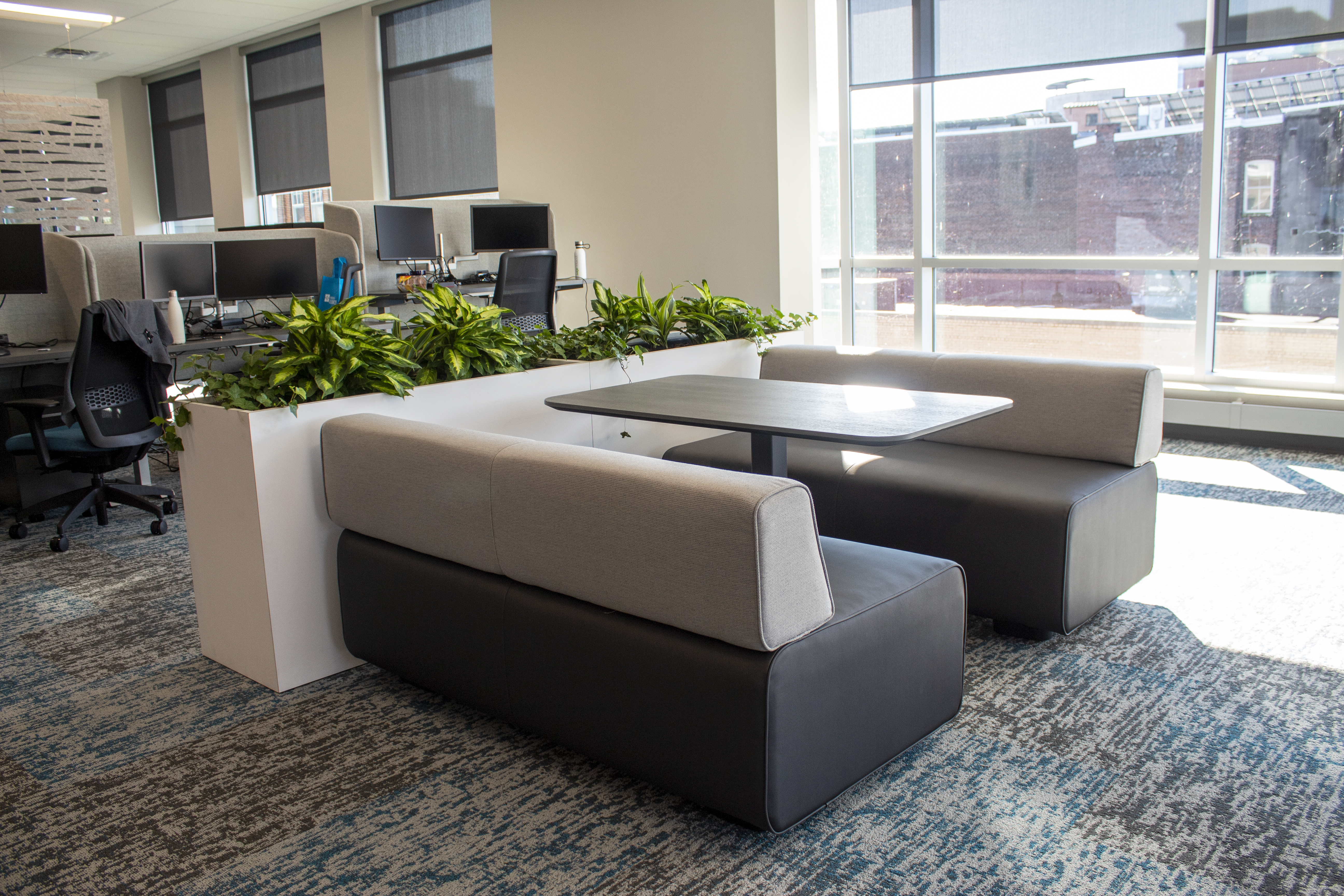 soft seating table and planters at cargas systems