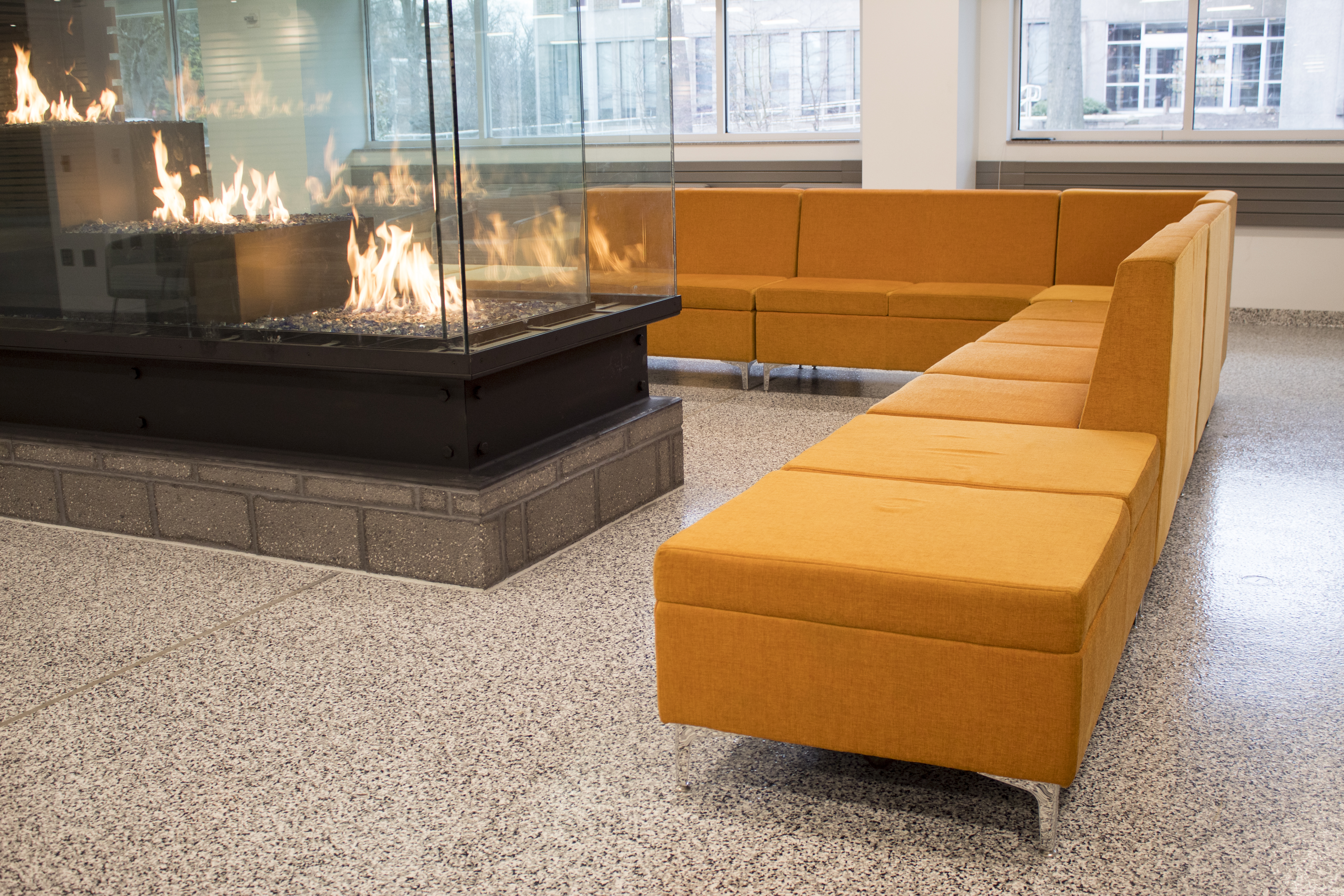resimercial seating around a fireplace at harrisburg area community college